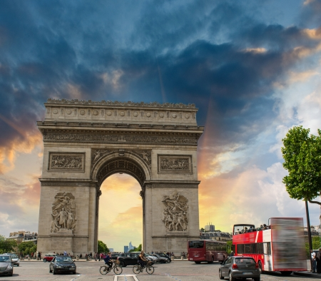 Stunning sunset over Arc de Triomphe in Paris. Triumph Arc Landmark.