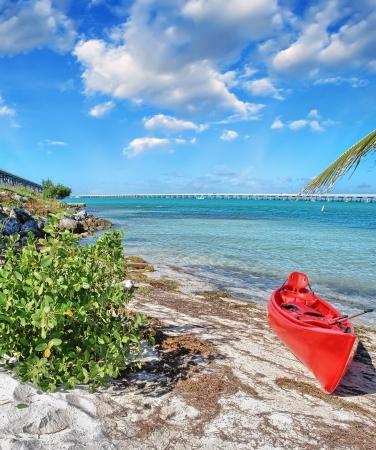 Small colourful boat on a beautiful beach. photo