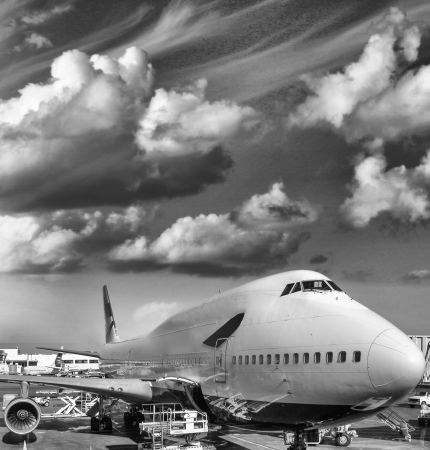 Large airplane ready for takeoff with Colourful sky  photo