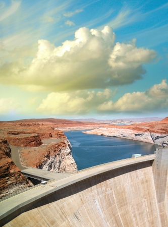 Hoover Dam, Arizona-Nevada border. Beautiful view of structure and Colorado river at sunset.