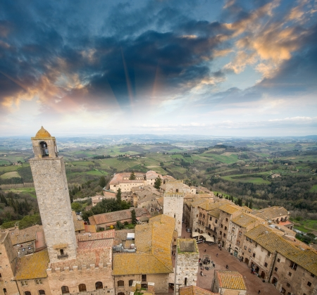 Classic medieval town of San Gimignano, Italy. Beautiful skyline at sunset. photo