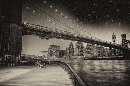 black bridge: Beautiful summer night in New York. Manhattant skyline from Brooklyn Bridge Park.
