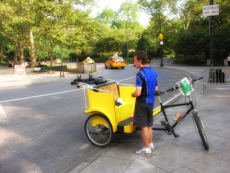 panning shot: NEW YORK CITY - SEP 30: Unidentified pedicab driver awaits next customer in Central Park on September 30, 2006. Pedicab is an eccentric yet very traditional in perspective of touring New York. Editorial