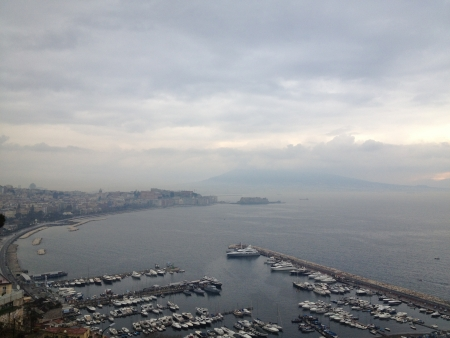 Wonderful aerial view of Gul of Naples with Vesuvius Volcano covered by Clouds. photo