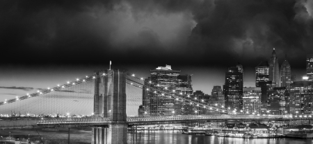 New York City Manhattan skyline and Brooklyn Bridge at dusk over East River with skyscrapers. photo