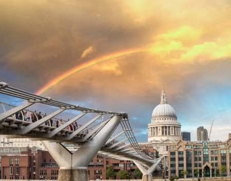 Rainbow over Millennium Bridge in London. St Paul Cathedral  photo