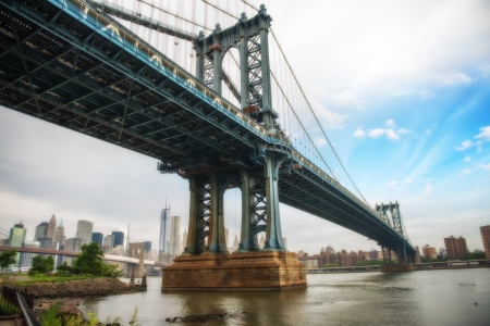 empire state building: The Manhattan Bridge, New York City. Awesome wideangle upward view. Stock Photo