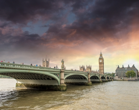 Beautiful sunset colors over Westminster Bridge and Big Ben - London. photo
