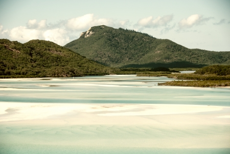 Whitehaven beach lagoon at national park queensland australia tropical coral sea world heritage. photo