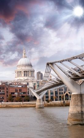 The Millennium Bridge and St Paul Cathedral, London. Portrait view with River Thames. photo