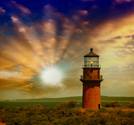 Lighthouse on a beautiful island. Sunset view with trees and sea.
