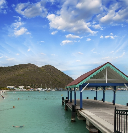 Wharf over a pristine caribbean beach at sunset. photo