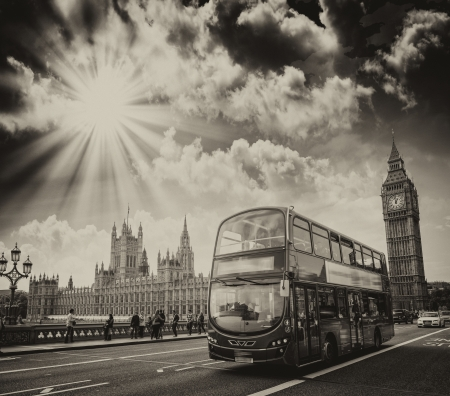 London. Beautiful sky colors over Westminster area with Double Decker bus crossing the bridge.