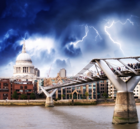 The Millennium Bridge and St Paul Cathedral. Bad weather in London.