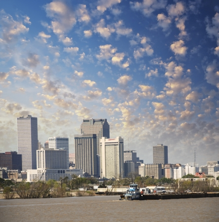 New Orleans, Louisiana. Mississippi river and beautiful city skyline at sunset. photo