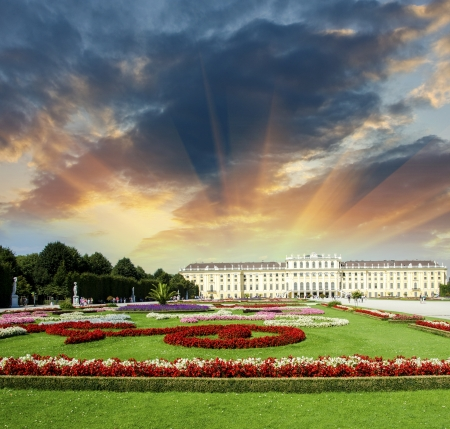 nbrunn: Wonderful gardens of Schonbrunn Castle in Vienna. Summer colors with sunset sky.