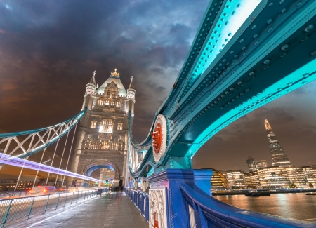 Night over Tower Bridge in London. Blue shapes of metal structure.