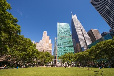 bryant park: Beautiful upward view of Skyscrapers in Bryant Park, New York. Editorial