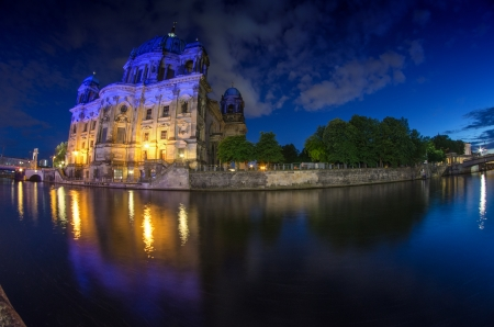 Berlin Landmarks and Buildings after sunset with river spree and deep blue sky, Germany photo