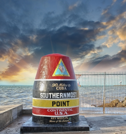 southernmost: Southernmost Point sign in Key West, Florida. Beautiful seascape with sunset sky.