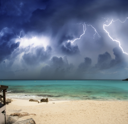 Beautiful beach at night with thunderstorm approaching. photo