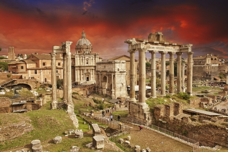 Sunset above Ancient Ruins of Rome - Imperial Forum - Italy photo