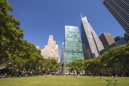 bryant: Beautiful upward view of Skyscrapers in Bryant Park, New York. Stock Photo