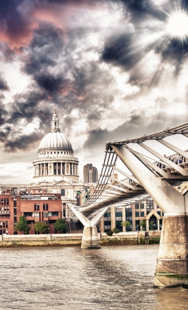 The Millennium Bridge and St Paul Cathedral, London. Portrait view with River Thames. photo