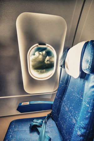 Airplane blue seat with a view. photo