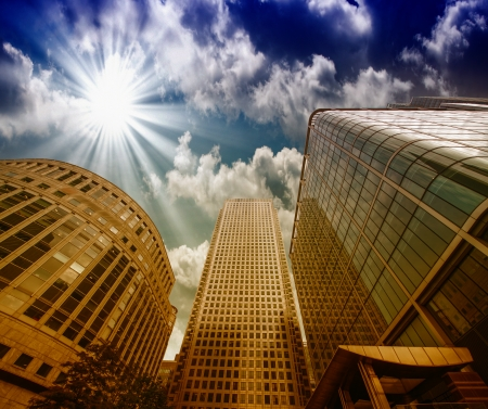 Group of Modern Buildings in London Financial District, beautiful upward view at sunset. Stock Photo