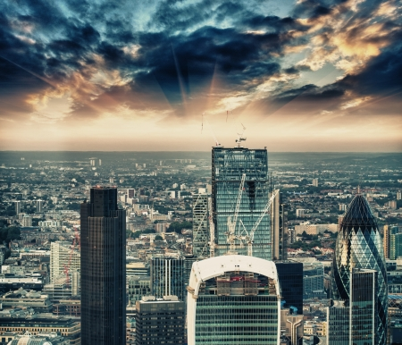 London. Stunning aerial view of modern financial district skyline at sunset.