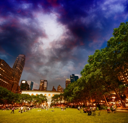 Bryant Park, New York. Relaxing at sunset on the grass.