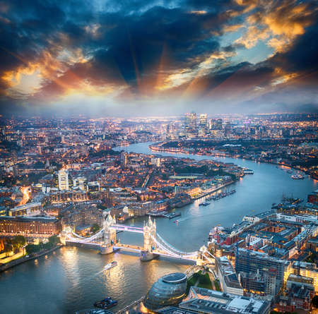 London. Aerial view of Tower Bridge at dusk with beautiful city skyline.