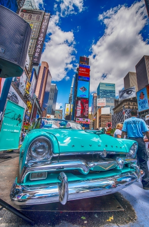 NEW YORK - MAY 22: Old car in Times Square, May 22, 2013 in New York City. Times Square is the most visited tourist attraction in the world with over 39 million visitors annually
