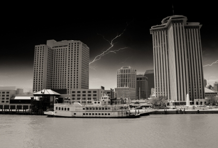 Skycrapers of New Orleans with Mississippi River photo