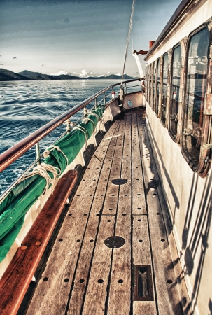 whitsundays: Overlooking the top deck of a sailboat while cruising on the Great Barrier Reef - Australia