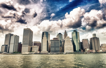 Buildings of Lower Manhattan as seen from East River - New York City. photo