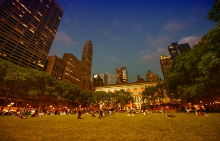 NEW YORK CITY - JUN 8: Tourists relax at sunset in beautiful Bryant Park, June 8, 2013 in NYC
