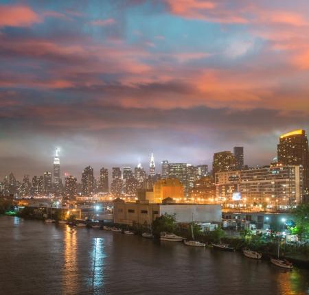 Wonderful night skyline of Manhattan from Queens.