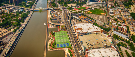 arial views: Helicopter view of Macombs Dam Bridge and Washington Heights - New York.