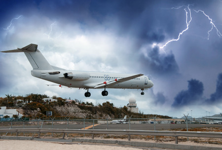 bad weather: Airplane landing in the storm.