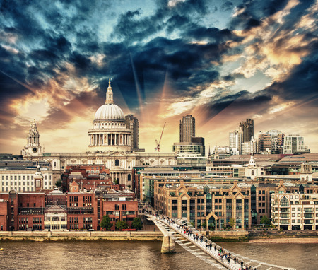 saint pauls cathedral: London. Beautiful aerial view of Millennium Bridge and St Paul Cathedral at sunset.