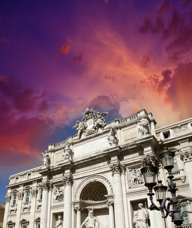 Rome, Italy. Trevi fountain building facade at dusk.