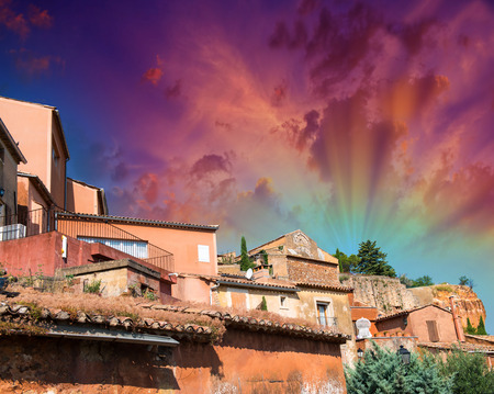 roussillon: Roussillon, France. Classic red homes with sunset sky colors.