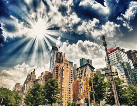 Buildings and trees of Columbus Circle on a summer day - New York City.