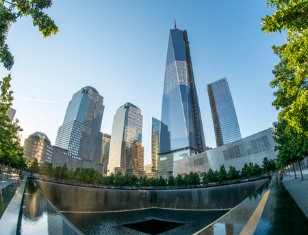 NEW YORK CITY - CIRCA JUNE 2013: NYCs 911 Memorial with new skyscrapers at World Trade Center Ground Zero. The memorial was dedicated on the 10th anniversary of the Sept. 11, 2001 attacks.
