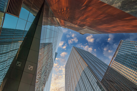 Skyward view of gigantic glass skyscrapers. Imagens