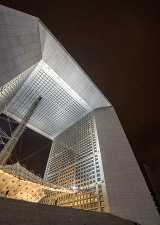 fense: PARIS - OCT 22, 2012: Grand Arche de la Defense at night. La Défense is Europes largest purpose-built business district with 560 hectares (5.6 million square metres) area.