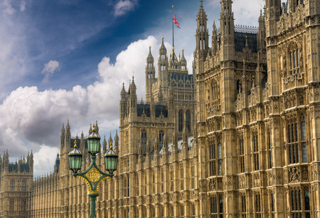 Houses of Parliament, Westminster Palace, London gothic architecture. Rectilinear frontal view. Stock Photo