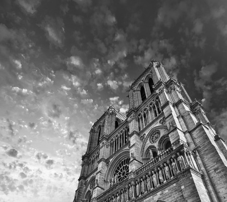 cite: Awesome upward view of Notre Dame Cathedral with dramatic sky - Paris.